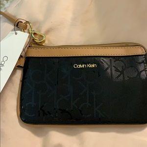 Shiny Calvin Klein mini wristlet it's NEW